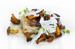 Fried cod. With chanterelles, cauliflower and truffles on a plate Stock Photo