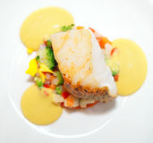Fried cod fillet. With vegetable mix and delicious mousse Royalty Free Stock Image