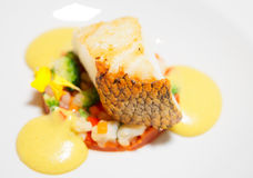 Fried cod fillet. With vegetable mix and delicious mousse Stock Image