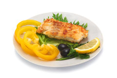 Fried cod fillet with fresh vegetables. And slice of lemon Stock Photo