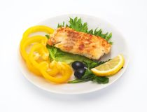 Fried cod fillet with fresh vegetables and slice of lemon Royalty Free Stock Photo