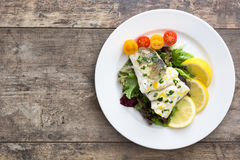 Fried cod fillet and salad Royalty Free Stock Photos