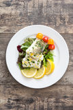Fried cod fillet and salad Royalty Free Stock Image