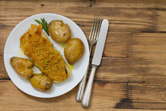 Fried cod fish with broa and potato on dish Stock Photos