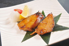 Fried cod. Fish with lemon and vegetables Stock Photo