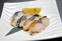 Fried cod. Fish with lemon and vegetables Stock Image