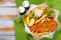 Fried cod, french fries, lemon slices Royalty Free Stock Image