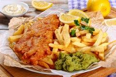 Fried cod, french fries, tartar sauce Stock Photos