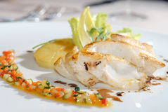 Fried cod with a potato. And vegetables Stock Image