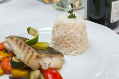 Fried cod with rice. And roasted vegetables Royalty Free Stock Images
