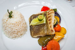 Fried cod with roasted vegetables. Fried cod with roasted vegetables and rice Stock Photo