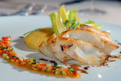 Fried cod with vegetables. Fried cod with a potato and vegetables Stock Photo