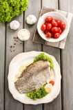 Fried cod on white plate with fresh vegetables Royalty Free Stock Photography