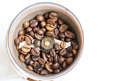 Fried coffee beans in a coffee grinder. Macro Vintage toning Stock Photography