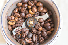 Fried coffee beans in a coffee grinder. Macro Vintage toning Royalty Free Stock Photos