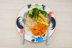 Fried 3 colors vegetable with brown rice on plate Royalty Free Stock Images