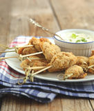 Fried cornmeal-crusted chicken bites with yogurt herb dressing Royalty Free Stock Photography
