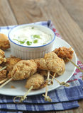 Fried cornmeal-crusted chicken bites with yogurt herb dressing Royalty Free Stock Photos