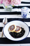 Fried Cottage Cheese cakes with flambe blueberries and teacup Stock Image