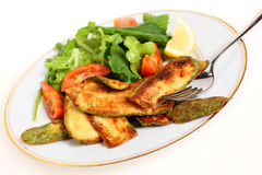 Fried courgette slices and salad Royalty Free Stock Photography