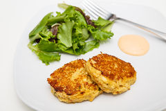 Fried Crab Cakes with Salad and Sauce Stock Photography