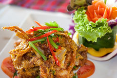 Fried crab with curry powder. On restaurant table Royalty Free Stock Images