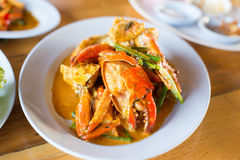 Fried crab with curry powder Stock Photos