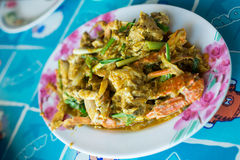 Fried crab with curry powder. The Thai seafood is a favor that fired crab with curry powder, chilli, onion and egg Stock Image