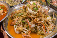 Fried crab in yellow curry. Thailand night street food. Fried crab in yellow curry, Stir-fried crab curry. Thailand night street food Stock Images