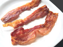 Fried crispy bacon strips Stock Image