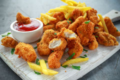 Free Fried Crispy Chicken Nuggets With French Fries And Ketchup On White Board Royalty Free Stock Photo - 96990355