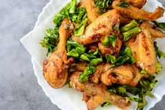 Fried crispy chicken wings with herbs royalty free stock images