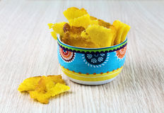 Fried crispy corn snack in mexican style bowl. On wood background royalty free stock photography