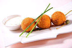 Fried crumbed scallops. With sauce stock photography
