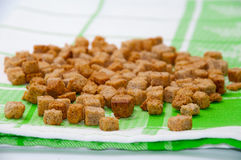 Fried cubes of bread flavored with bacon Royalty Free Stock Photography