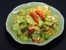 """Fried Cucumbers with Egg and garlic and chilli, Thai Food. Name """"Tang Kwa Pad Khai"""", Isolated on Black Background Royalty Free Stock Photography"""