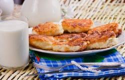 Fried curd pancakes  and milk Stock Photos