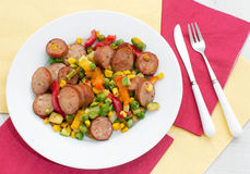 Fried cut sausages and bright vegetables Stock Image