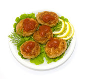 Fried cutlet. Lemon and lettuce on a plate Stock Photos