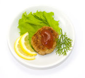 Fried cutlet, lemon and lettuce Royalty Free Stock Image