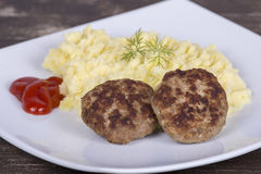 Fried cutlet with mashed potatoes on a white plate Royalty Free Stock Images