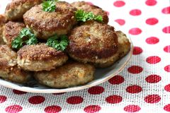 Fried cutlets. Homemade roasted beef burgers laid in a heap on a plate Royalty Free Stock Photo