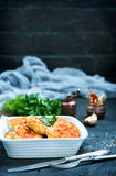 Fried cutlets. In bowl and on a table Stock Image
