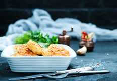 Fried cutlets. In bowl and on a table Royalty Free Stock Images