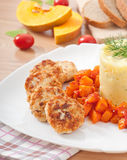 Fried cutlets, stewed pumpkin Royalty Free Stock Images