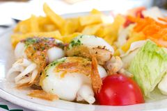 Fried cuttle fish with salad Stock Image