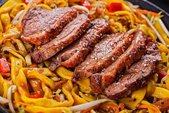 Fried dack meat with egg noodles Stock Image