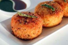 Fried Dhokla. Dhokla is a vegetarian food item that originates from Gujarat in India. It is made with a fermented batter of gram flour Stock Photo