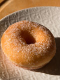 Fried Donut With Sugar in Witte Schotel stock foto