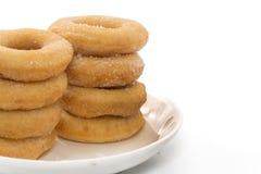 Fried Donuts com a cobertura do açúcar isolada fotos de stock